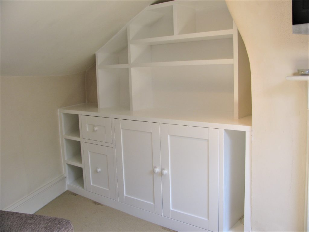 Fitted loft room storage unit.